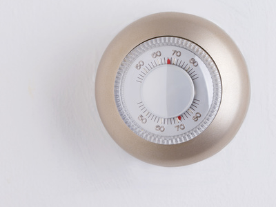 If your thermostat looks like this old one, it might be time to upgrade to a high efficiency furnace